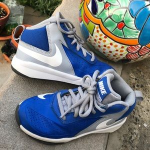 Child Blue and Gray NIKE Team Hustle D7 sneakers.